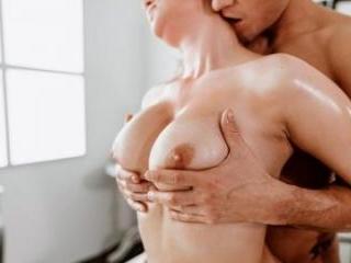 Big Tits Redhead Given Oil Massage