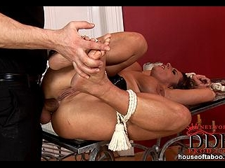 Bound babe fucked in ass on table