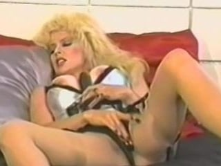 A Big Boobs Blonde Jerks Off With A Big Black Dild