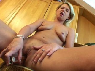 Small titted blonde mom is toying her cunt