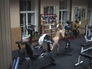 Charming doll exercising naked in the gym!
