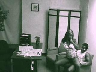 Interracial fuck in the office filmed by security