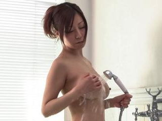 Passionate Chihiro Akino plays with her big tits a