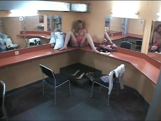 Sassy chick masturbating in makeup room!