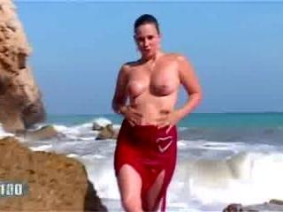 Bit tit blonde stripping on the beach