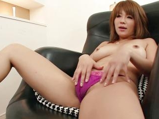 Rika Aina in fishnet nylons plays with her furry s