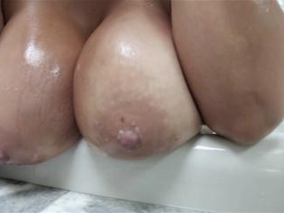 Bridgette B classy MILF gives a tits fuck