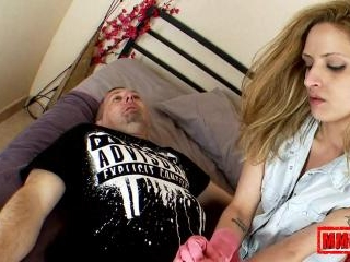 Blonde slut giving handjob with plastic gloves
