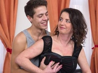Mature lady sucking and fucking her toy boy