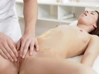 Sexy brunette enjoys banging on the massage table