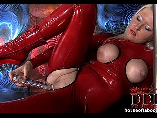 Blonde pole dancing in latex
