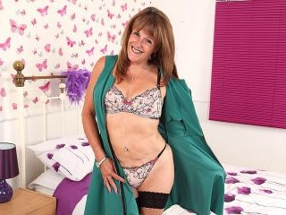 Naughty British mature lady playing with her wet p