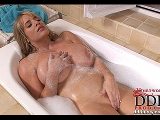 Big boobs under the hot water