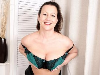 Big breasted British housewife playing with hersel