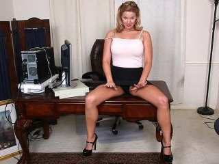 Naughty American MILF playing with her pussy at th
