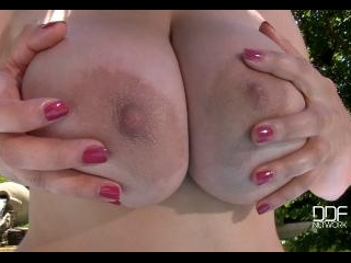Natural Tits Superstar Teases With Cleavage in Poo