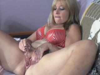 Busty blonde housewife Liisa is using a glass dild