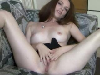Horny redhead hottie Raine is finger banging her t