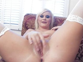 Kelly Surfer plays with her tight shaved pussy