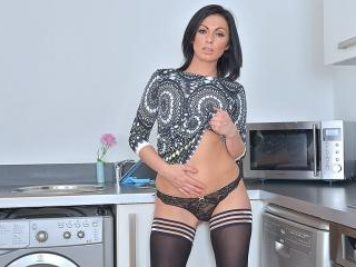 Hot British mom getting naughty in the kitchen