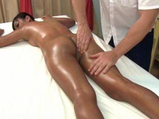 Cute oiled babe gets her firm butt massaged