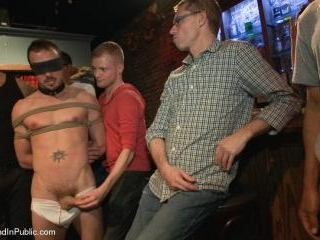 Stud in a metal cage is fucked by horny bar patron