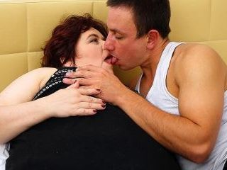 Big curvy mature lady fucking and sucking her youn