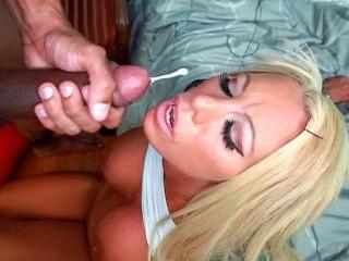 Blonde white girl swallows some big black cock
