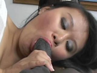 Asian slut Kiwi Ling swallows a big black cock and