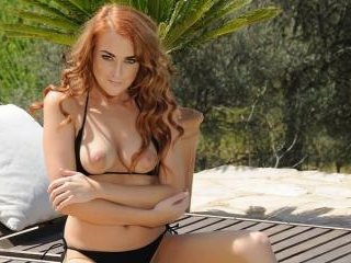 Lucy Anne in black bikini by the pool