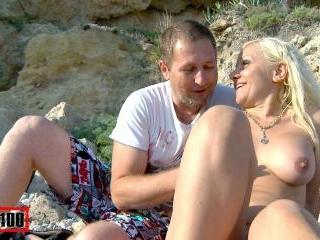 Nudist couple on a sunny beach