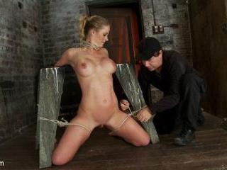 Elbows bound, knees on hard wood, nipple suction,