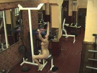 Sexy brunette stripping in the gym!