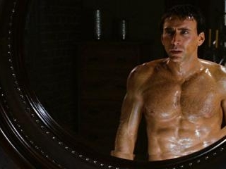 Nicolas\' abs make a guest appearance in the mirror