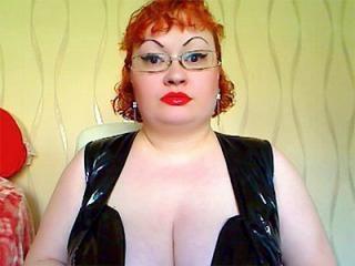 Redhead BBW MissTania Flashes Her Huge Tits