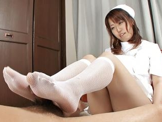 Nurse Ai Ootomo gives her patient a foot and titty