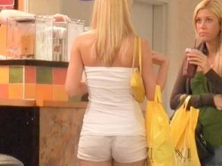 Long haired blonde chick in tight white shorts was