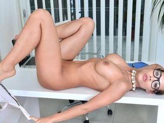 Sexy milf masturbates on her office desk