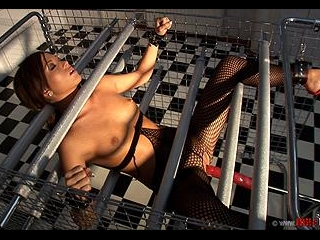 Natalia Forrest gets bound in a cag