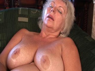 Huge titted grandma toying her old snatch