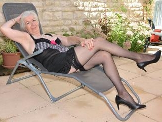 Horny British mature lady getting wet in her garde