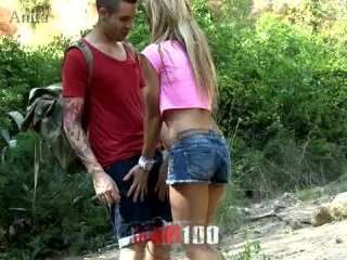Young couple getting private in the woods