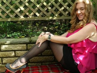 Naughty British cougar playing in the garden