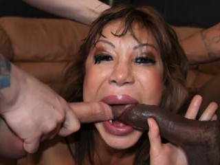 Hot MILF gets her face fucked by two cocks
