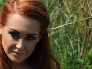 Lucy Anne strips nude in the rock garden