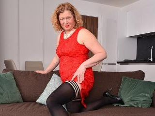 Naughty curvy British housewife playing with herse