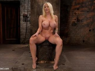California blond with huge tits has them bound to