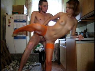 Teen in orange nylons takes cock