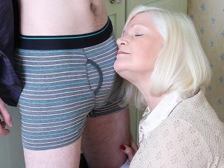 Big British housewife playing with her toy boy