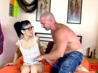 Horny brunette Megan Hot removing clothes